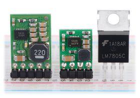 Pololu step-down voltage regulators D24V10Fx and D24V5Fx next to a 7805 voltage regulator in TO-220 package.